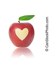 Red apple with heart - Red apple with a heart shape carved...