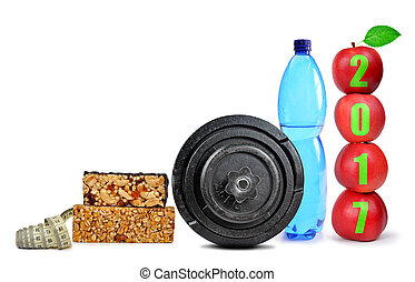 Healthy resolutions - Red apples, dumbbell and PET bottle...