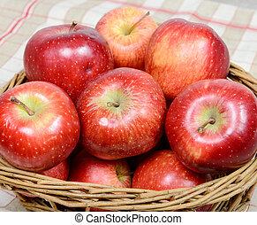 Red apples in a basket wicker