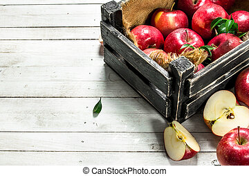 Red apples in a box.