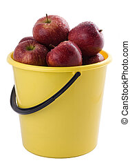 red apples in a yellow bucket