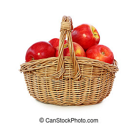 Red apples in basket isolated on white background.