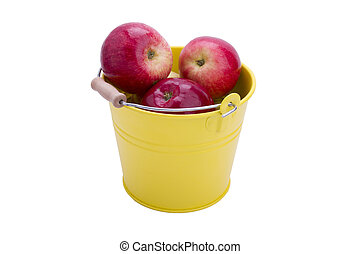 Red apples in the yellow bucket