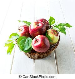 Red apples in wicker basket