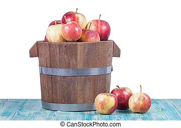 Red apples in wooden bucket