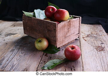 Red apples in wooden crate