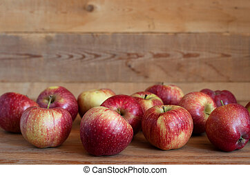 Red apples lie on a wooden surface - Ripe red apples lie on ...