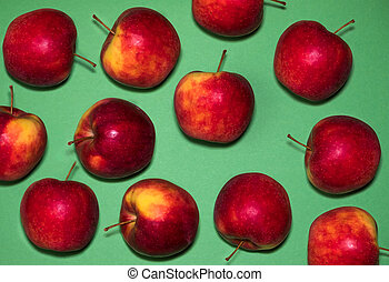 red apples on a green background