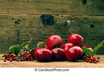 red apples on a wooden background