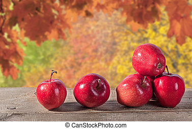 Red apples on a wooden table