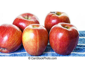 Red Apples on Blue Towel and White Background