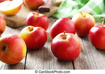 Red apples on grey wooden background