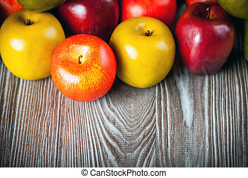Red apples on wooden table close up copy space