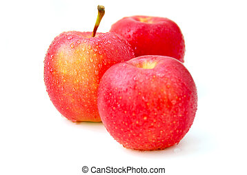 Red apples - Three red apples with water droplets on white...