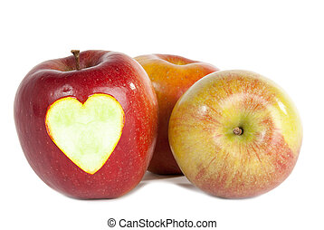 Red apples with heart isolated on white