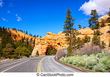 Arch road tunnel - Red Arch road tunnel on the way to Bryce...