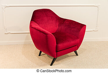 Red armchair against a white wall