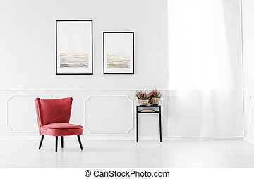Red armchair against white wall