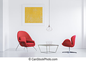 Red armchairs at designer table