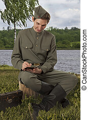 Red Army soldier writing a letter