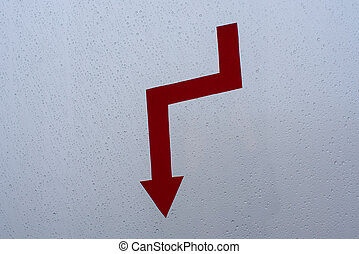 Red arrow - falling chart on glass with raindrops