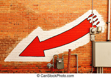 Red Arrow Painted on a Brick Wall