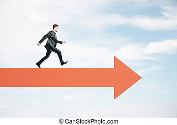Red arrow with running businessman