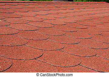 Red asphalt shingle roofing on a roof