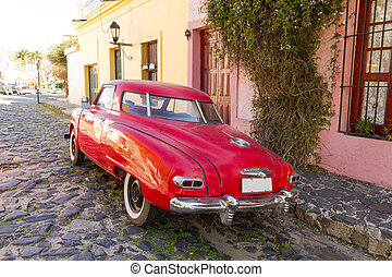 Red automobile on one of the cobblestone streets, in the city of Colonia del Sacramento, Uruguay. It is one of the oldest cities in Uruguay.