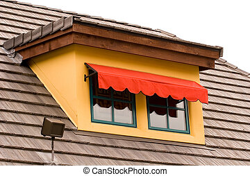 Red Awning on Gold Dormer - A colorful awning and dormer on...