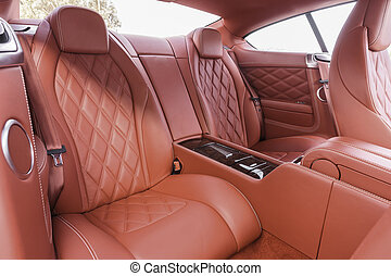 Red back passenger seats in modern luxury comfortable car