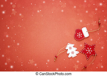 Red background with Christmas decorations. Space for text.