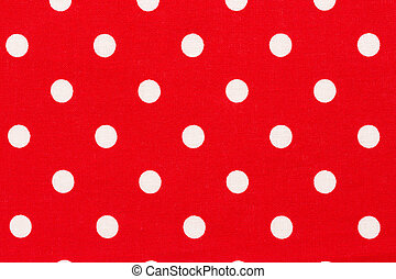 Red background with white polka dots pattern.