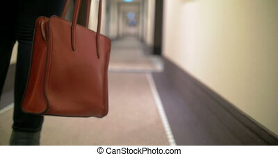 Red Bag in Female Hands