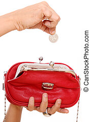 Red bag - Woman's hand putting a coin in a red bag