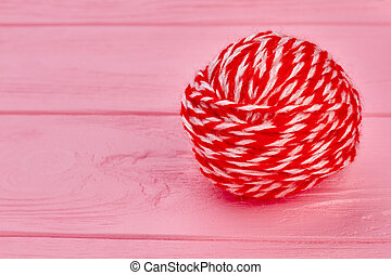 Red ball of yarn and copy space.