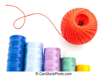 red ball of yarn and threads