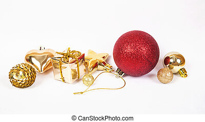 Red ball with other Christmas baubles like holiday decoration on white.