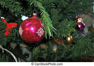 red ball with snowflake. vintage christmas toys on new year tree background.