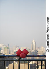 Red balloon heart on a fence
