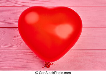 Red balloon in a shape of heart.
