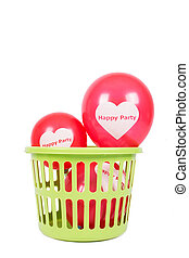 red balloon in green basket