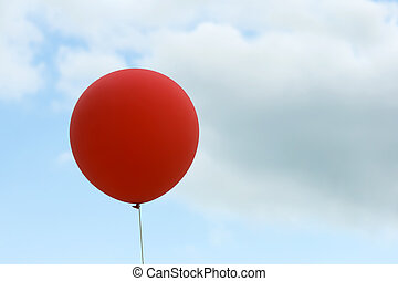 red balloon on sky background