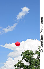 red balloon on sky background with clouds