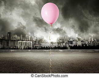 Red balloon on stormy gray background