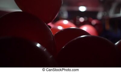 Red balloons in a bus - Red balloons inside a bus at night...