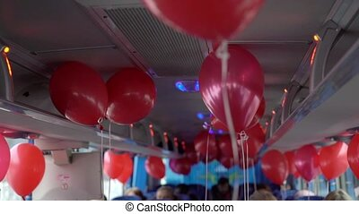 Red balloons in a bus - Red balloons inside a bus driving...
