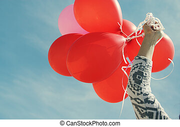 red balloons on the background of blue sky