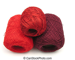 Red balls of wool on a white background