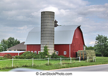 Red barn and silo without cap - A red barn with a white roof...
